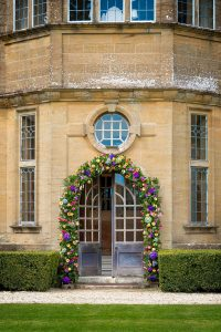 Minterne Gardens house colourful flower arch
