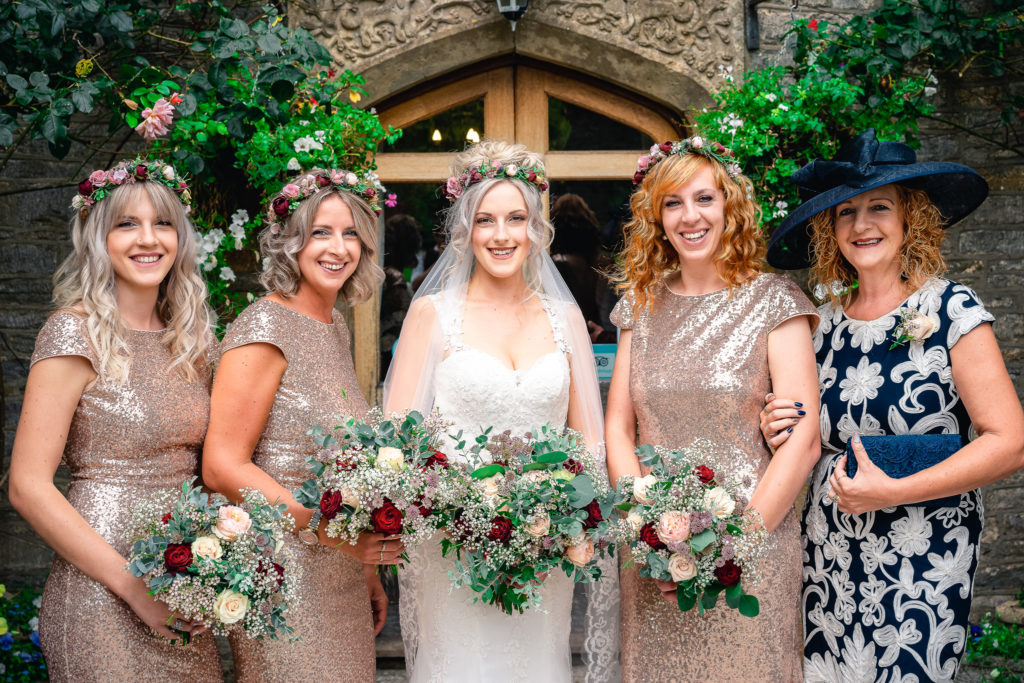 a bride, her bridesmaids and her mother ready for the wedding ceremony at The Old Milking Parlour at Cavokay House in Somerset