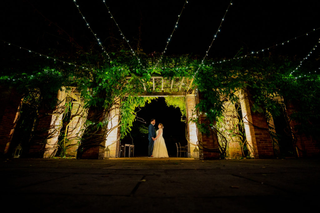 A night portrait with fairy lights of a bride and groom on their wedding day at Carlton House in Shepton Mallet in Somerset.