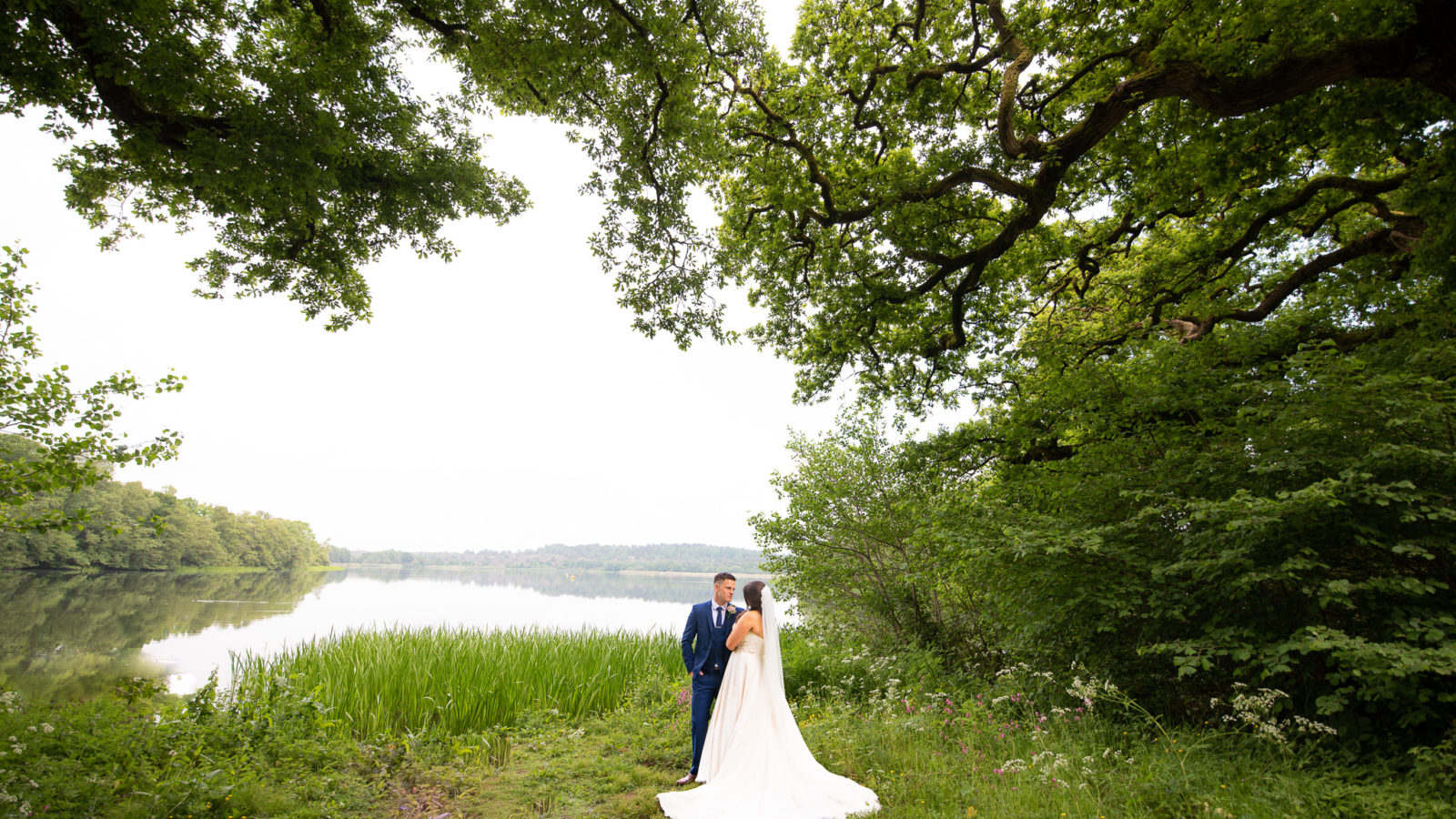 A couple by the lake at Shearwater in Wiltshire