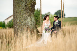 A bride and groom on the swing at Quantock Lakes in Somerset