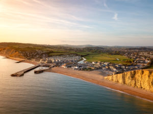 A photograph of West Bay in Dorset from a drone.